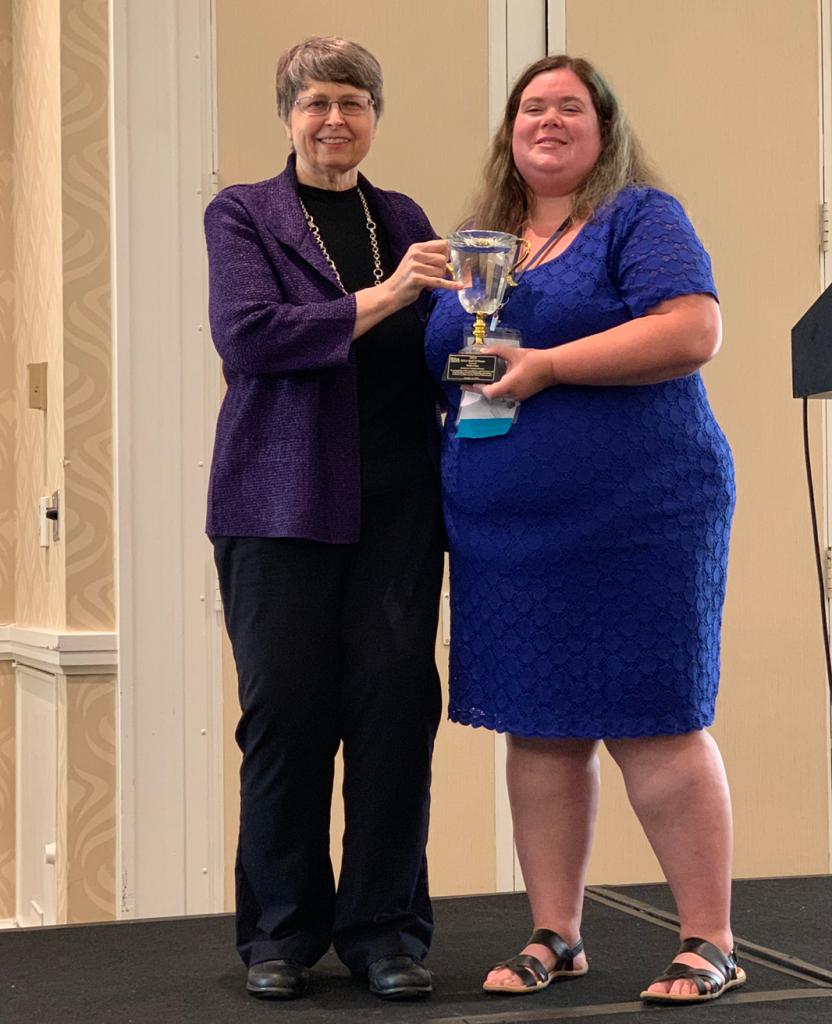 Faith accepting her SCLA Hall of Fame award