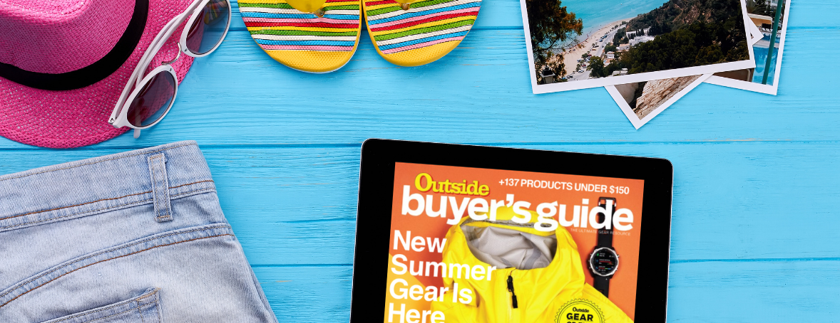 Beach items with a tablet featuring Outdoor magazine